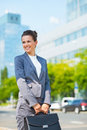 Business woman with briefcase in office district looking aside into the ultra modern trends smiling modern Stock Photography