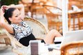 Business woman in cafe young beautiful relaxing Stock Photography