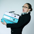 Business woman carrying files and folders studio shot portrait of one caucasian young businesswoman wearing heavy Royalty Free Stock Photography