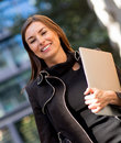 Business woman carrying a laptop Royalty Free Stock Photo