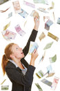 Business woman catching flying euro money happy lucky banknotes Stock Image
