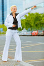 Business woman catching taxi near office center Royalty Free Stock Photos