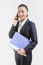 Business woman with cell phone isolated on white background Royalty Free Stock Photos