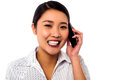 Business woman closing deal over a phone call smiling corporate asian communicating through cellphone Royalty Free Stock Image