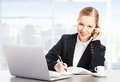 Business woman with a computer laptop and phone Royalty Free Stock Photo