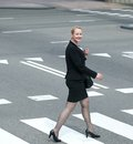 Business woman crossing the street in the city full length portrait of a Royalty Free Stock Photography