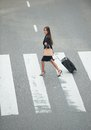 Business woman crossing at zebra crossway portrait of a with travel bags Royalty Free Stock Photos