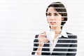 Business woman with cup of coffe looking through a venetian blind in an office Royalty Free Stock Image