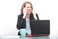 Business woman at desk laughing and talking on phone Royalty Free Stock Photo