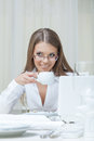 Business woman drinking coffee in restaurant close up Stock Images