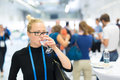 Business woman drinking glass of water during break at business conference. Royalty Free Stock Photo