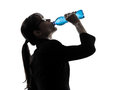 Business woman drinking water energy silhouette one dr k g studio isolated on white background Royalty Free Stock Photos