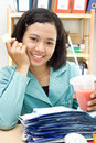 Business woman eat and drink at work Royalty Free Stock Photo