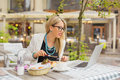 Business woman eating lunch and working on laptop Royalty Free Stock Photo