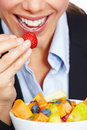 Business woman eating strawberry Stock Image