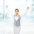 Business woman excited hold hands up raised arms surprised happy smile isolated over white background concept Royalty Free Stock Image