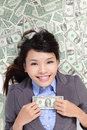 Business woman excited lying on money bed Royalty Free Stock Photos