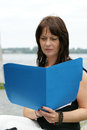 Business woman with a file folder middle aged outdoors Royalty Free Stock Photo