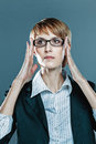 Business woman focusing herself with hands on her spectacles blue background Royalty Free Stock Photo