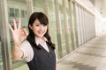 Business woman give you ok sign closeup portrait outside modern city Stock Photos