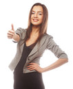 Business woman giving thumbs up portrait of attractive over white background Stock Photo