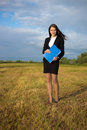 Business woman on green field Royalty Free Stock Photography