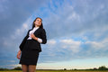 Business woman on green field Stock Images