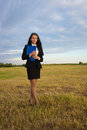 Business woman on green field Stock Photo