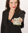 Business woman hands you cash payment twenty dollar bills brunette wokman in a suit holds out some to the viewer Stock Photos
