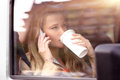 Business woman having coffee in the car Royalty Free Stock Photo