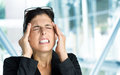 Business woman headache and stress or anxiety attack crisis businesswoman suffering painful migraine or in work Royalty Free Stock Image