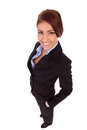 Business woman with her hands in  pockets Royalty Free Stock Image