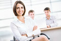 Business woman with her staff successful women in background at office Stock Images