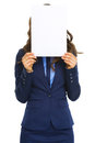 Business woman hiding behind blank paper sheet isolated on white Royalty Free Stock Photo