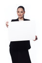 Business woman holding a banner happy smiling young blank placard isolated on white Stock Image