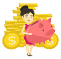 Business woman holding big piggy bank.