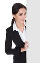 Business woman holding blank placard happy smiling young isolated on white Royalty Free Stock Photo