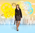 Business woman holding a briefcase standing on the background of skyscrapers Royalty Free Stock Photo