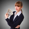 Business woman holding cash dollars happy in the hands of welcoming smile the concept of finance success isolated space for text Royalty Free Stock Image