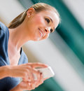 Business woman holding cell phone and texting Royalty Free Stock Photos