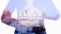 Business woman Holding CLOUD NETWORKING message double exposure with blur city Royalty Free Stock Photo