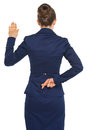 Business woman holding crossed fingers behind back Royalty Free Stock Photo