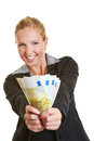 Business woman holding euro money fan cheering happy Royalty Free Stock Photography