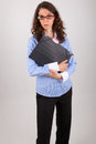 The business woman is holding a file in her hands Royalty Free Stock Photo