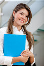 Business woman holding a folder Royalty Free Stock Image