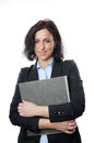 Business woman holding folder in front of her chest Royalty Free Stock Photos
