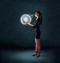 Business woman holding glowing planet earth Royalty Free Stock Photo