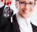 Business woman holding keys over white background Stock Image
