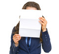 Business woman holding letter in front of face isolated on white Royalty Free Stock Images