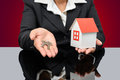 Business woman holding a model house and key Royalty Free Stock Photo